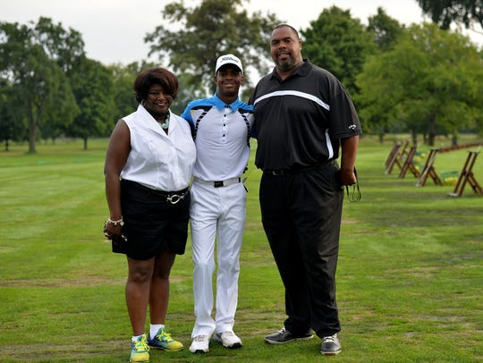 Bryce Henderson (center), shown with parents Ramona