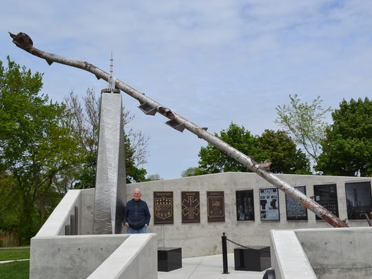 Artist James Havens stands in the Public Safety Service Memorial in Gibsonburg featuring a 36-foot section of the antenna from the North Tower of the World Trade Center. The 16th anniversary of the 9/11 attacks will be remembered in a service at the memorial on Monday.