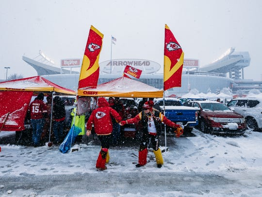 KANSAS CITY, MO - JANUARY 12: Kansas City Chiefs fans dance in a snow-filled parking lot while tailgating prior to the AFC Divisional Round playoff game between the Kansas City Chiefs and the Indianapolis Colts at Arrowhead Stadium on January 12, 2019 in Kansas City, Missouri. (Photo by Jason Hanna/Getty Images)