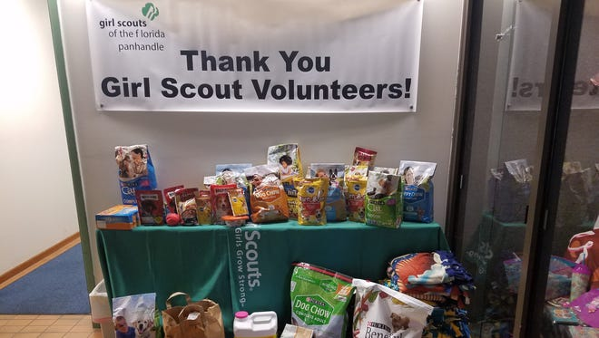 Through a community project, local Girl Scouts were able to donate pet supplies to the Pensacola Humane Society.