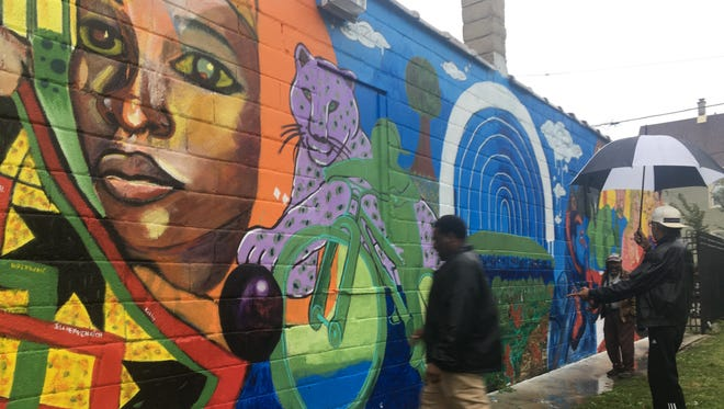 Members of the Milwaukee Art Project, a coalition of African-American artists founded in the wake of the unrest in Sherman Park last year, unveiled its first big project on Saturday, a mural in the Walnut Hill neighborhood.