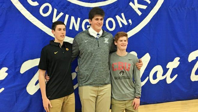 CovCath basketball signess, from left, CJ Fredrick (Iowa), Jake Walter (Xavier), Aiden Ruthsatz (Christian Brothers), Nov. 8, 2017.