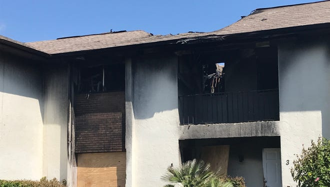 A condominium at 1057 Sixth Ave. caught fire Sunday.