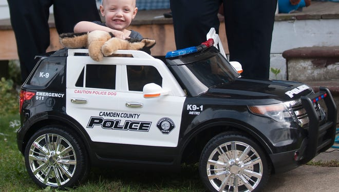 Ben Graham, a 3-year-old cancer patient, smiled in a police car presented to him in October 2017 by members of the Camden County Police Department. The Elmer boy died Friday.