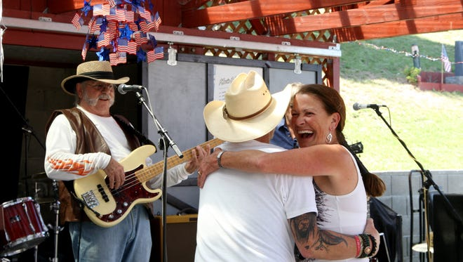 Victor Henry and Jeanne Kennada dance at the Labor Day celebration.
