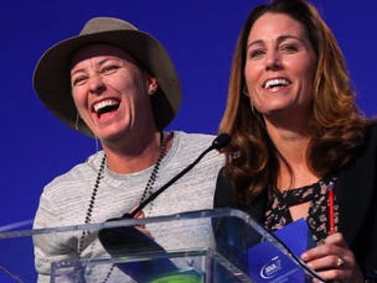 Former U.S. Women's Soccer Team player Abby Wambach, left, is on stage with fellow veteran Julie Foudy while closing out the 2016 ANA Inspiring Women in Sports Conference at Mission Hills Country Club in Rancho Mirage.