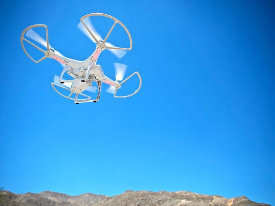 A DJI Phantom drone operated by Alan Carvalho of Cathedral City takes flight near the San Jacinto Mountains on July 13, 2015.