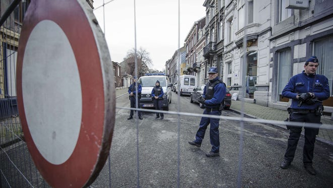 Police stand guard at Colline Street in Verviers, eastern Belgium, on Jan. 16.