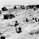 Men and equipment line an invasion beach June 6, 1944.