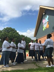 A choir from at Higher Ground Church performed at Race