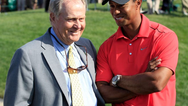 Jack Nicklaus, left, talks with Tiger Woods after Woods won the Memorial golf tournament at the Muirfield Village Golf Club in Dublin, Ohio. The PGA Tour has a deal that would bring a one-time event to Muirfield Village a week before the Memorial, giving it tournaments in consecutive weeks.