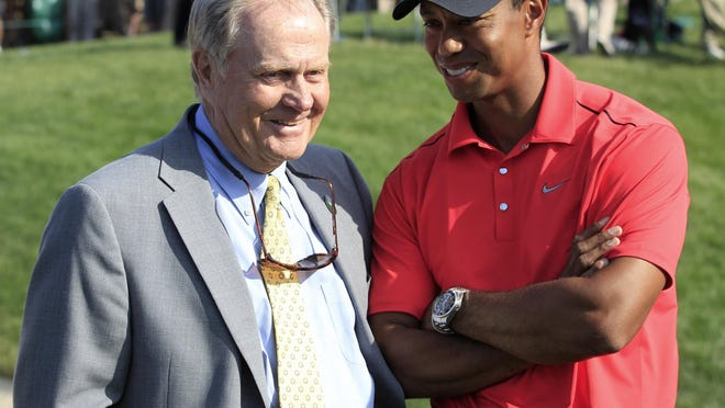 FILE - In this June 3, 2012, file photo, Jack Nicklaus, left, talks with Tiger Woods after Woods won the Memorial golf tournament at the Muirfield Village Golf Club in Dublin, Ohio. The PGA Tour has a deal that would bring a one-time event to Muirfield Village a week before the Memorial, giving it tournaments in consecutive weeks.