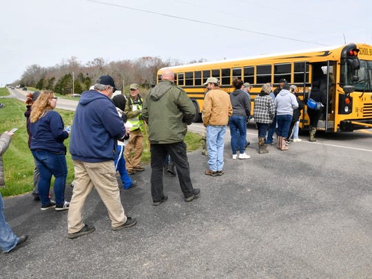 Volunteers load onto a bus to be transported to the area where searchers continue looking in Dickson County for missing 5-year-old Joe Clyde Daniels.Thursday April 5, 2018, in Dickson, Tenn