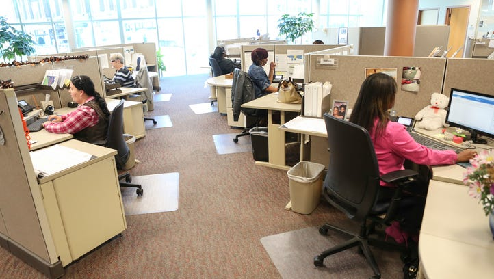 Louisville Water Company call center employee took customer calls in October at the downtown Louisville office. Oct. 15, 2015