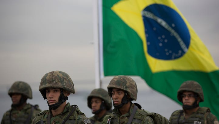 Brazilian marines stand in formation during a training drill simulating a terrorist attack on a ferryboat on July 21, 2016, as the country prepares for the Olympic Games in Rio de Janeiro.