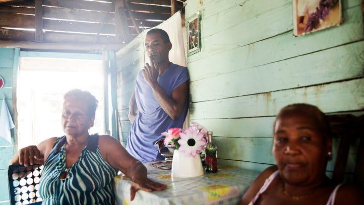 Enilda Cara Mendoza, 70, from left, Armando Moya Torres,