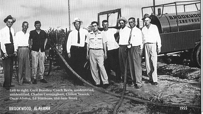 Brookwood volunteer firefighters and tank truck, 1955: From left: Cecil Brantley, Coach Bevis, unidentified, unidentified, Charles Cunningham, Clifton Yessick, Oscar Abston, Ed Simmons, and Sam Toxey. Can you identify others? Reach bettyslowe6@gmail.com.