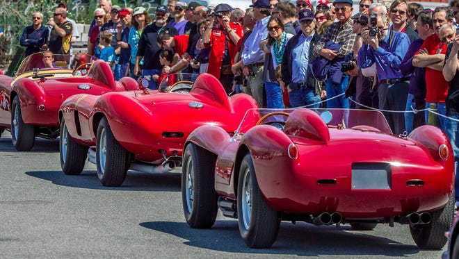 The large crowd attending a Ferrari themed Demo Day at the museum behold a very rare sight . (from right) A 1958 250 Testa Rossa,  a1955 857 Monza and a 1954 375MM. These 3 cars helped build Ferrari's reputation during the 1950's as one of the premiere sports car brands in the world.  Photo/BOB CRAIG