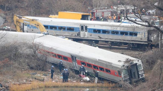A rail crew works at the scene of the fatal Metro-North train derailment on December 2, 2013 in the Bronx near the Spuyten Duyvil station. The Metro-North passenger train derailed en route to New York City near the Spuyten Duyvil station, killing four people and wounding 63 others on December 1, 2013. (Ricky Flores/The Journal News)
