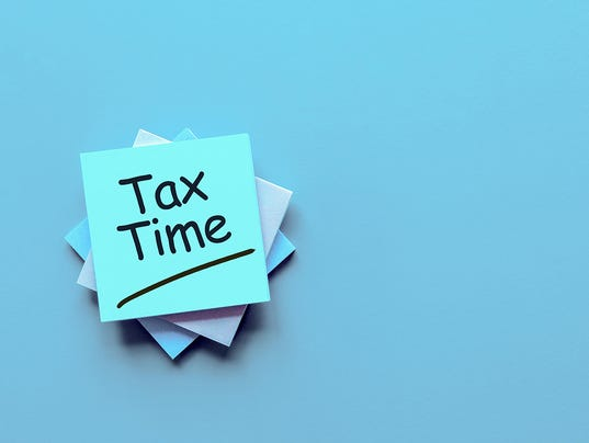 Tax time - message on an office desk with empty space for text, mockup or template