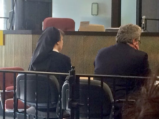 Sister Kimberly Miller (left) sits  with her attorney Jeff Lindy before Washington Township municipal court Judge Martin Whitcraft before he announces his ruling April 20, 2016.