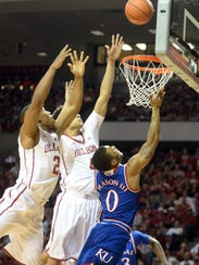 Kansas Jayhawks guard Frank Mason III (0) drives to