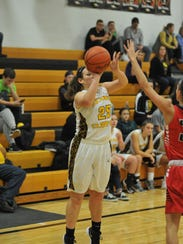 Colonel Crawford's Allison Teglovic shoots a 3-pointer