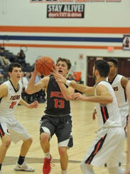 Buckeye Central's Max Loy drives to the basket with