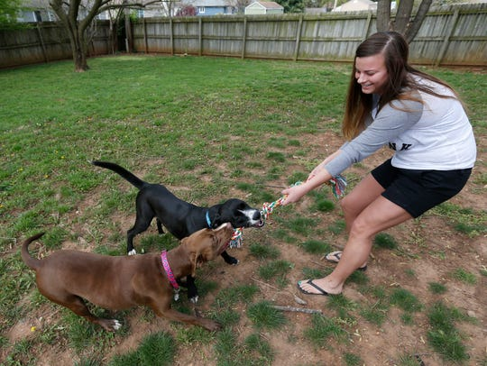 Anna Dankert plays with Oliver and Molly in her backyard