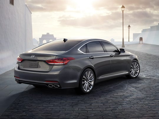 Step behind the 2015 Hyundai Genesis 5.0 for a view of the rear quad exhausts.