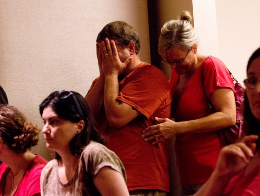 Robert and Pamela Burroughs show their frustration after they realize that the Lee County School Board is going to rescind their vote to opt-out of common core and standardized testing.