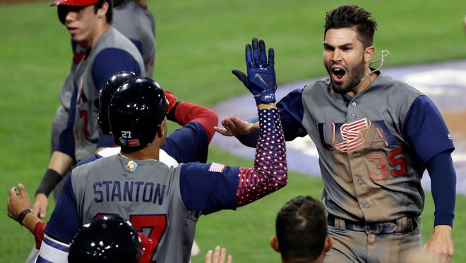 USA's Eric Hosmer celebrating with teammates after scoring on a two-run double by Andrew McCutchen during the eighth inning of a second-round World Baseball Classic game against the Dominican Republic on Saturday.