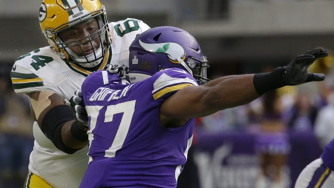Green Bay Packers offensive tackle Justin McCray (64) blocks Minnesota Vikings defensive end Everson Griffen (97) during the third quarter of their game against the Minnesota Vikings Sunday, October 5, 2017 at U.S. Bank Stadium in Minneapolis, Minn. The Minnesota Vikings beat the Green Bay Packers 23-10.  MARK HOFFMAN/MILWAUKEE JOURNAL SENTINEL