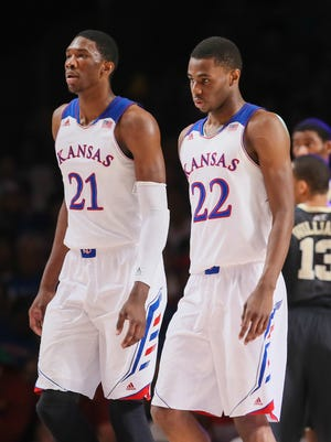 Kansas Jayhawks guard Andrew Wiggins (22) and center Joel Embiid (21) react during a game last season.