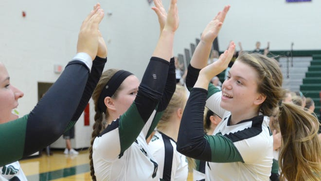 Novi senior setter Erin O'Leary (right) was named Michigan Gatorade Player of the Year for the second time.