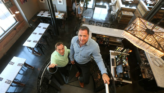 Peter Lezeska (right) a real estate agent and John Nacca, a lawyer, are opening a high end restaurant Nosh, in the Neighborhood of the Arts area of Rochester.