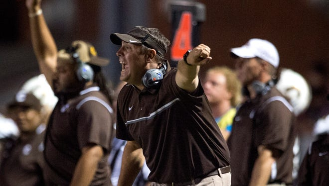 Central Head Coach Andy Owen gestures to his team as the Central Bears take on the Memorial Tigers at Enlow Field in Evansville, Ind., on Friday, Sept. 29, 2017. Central won 35-7.