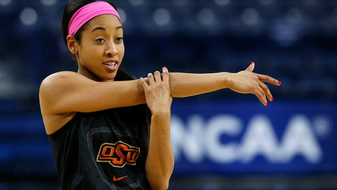 March 28, 2014 - Oklahoma State guard Tiffany Bias stretches during an NCAA women's tournament practice at the Purcell Pavilion in South Bend, Ind.