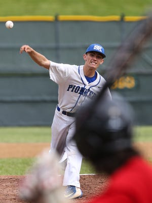 Simon Kenton's Logan Scott pitches to Holy Cross' Michael Wilson during the first inning.
