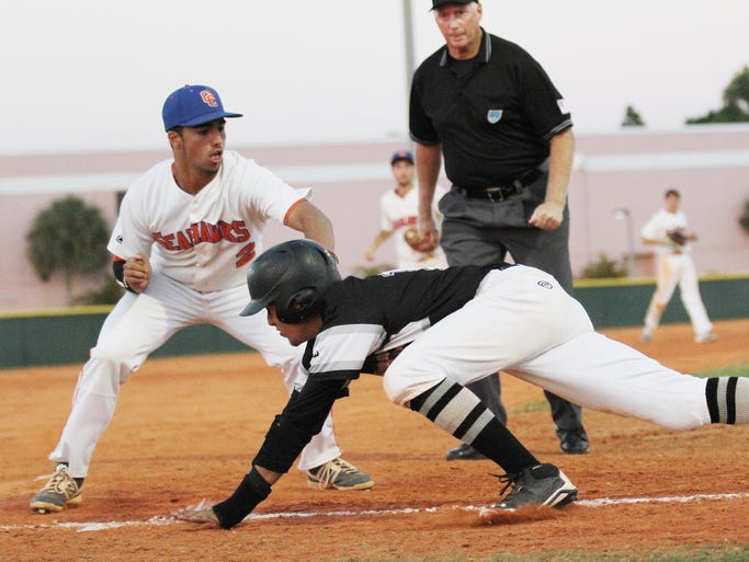 Cape Coral's Kyle Arjona tags Mariners Victor Marrero at 3rd base during the distict 5A-12 championship game at Cape Coral High School on Thursday.