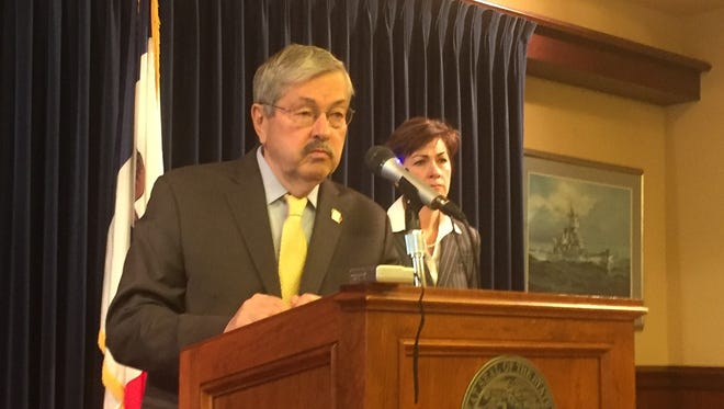 Gov. Terry Branstad talks with reporters at the Iowa Capitol on Nov. 28, 2016. On his right is Lt. Gov. Kim Reynolds
