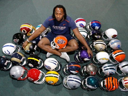 Former UTEP running back Aaron Jones now sits and waits to see which NFL team will call his name during the upcoming draft that begins on Thursday April 27, in Philadelphia. Jones has been invited by the NFL to attend the draft and will leave for Philadelphia this week. Here Jones sits in the middle of all 32 NFL team helmets at Sport Xplosion in central El Paso.