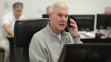 Green Bay Packers general manager Ted Thompson talks on the phone inside the draft room during the 2014 NFL draft at Lambeau Field.