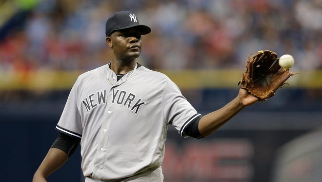 New York Yankees starting pitcher Michael Pineda gets a new baseball against the Tampa Bay Rays during the first inning of a baseball game Saturday, May 28, 2016, in St. Petersburg, Fla.
