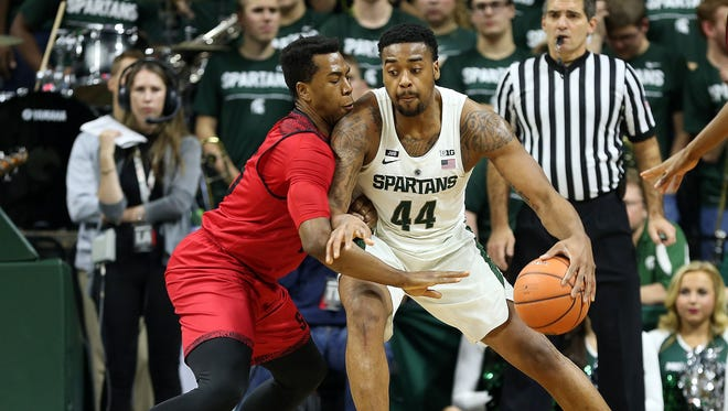 Michigan State Spartans forward Nick Ward (44) is defended by Southern Utah Thunderbirds forward Jamal Aytes (15)  during the first half of a game at Jack Breslin Student Events Center.
