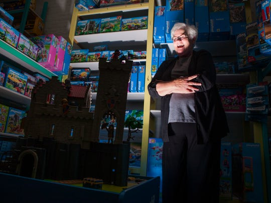 Pufferbellies owner Susan Blanton, who hosts a scary story time for children around Halloween, poses for a portrait inside her toy store in Staunton on Friday, Oct. 16, 2015.