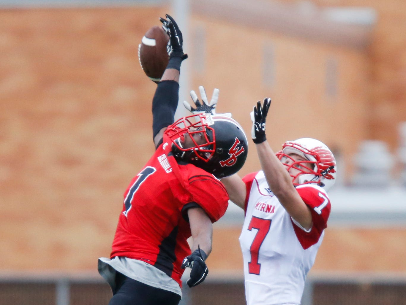 William Penn's Zach Burton (left) defends a pass meant for Smyrna's Brandon Bishop in the fourth quarter of Smyrna's 30-13 win in a semifinal of the DIAA Division I state tournament at Bill Cole Stadium Saturday.