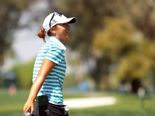 Current world no. 1 women's golfer Lydia Ko, 17, laughs with a playing partner on the first green Wednesday, April 1, 2015 while playing in the ANA Inspiration pro-am in Rancho Mirage, Calif.