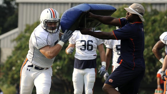 Auburn promoted linebackers coach Travis Williams a full-time position after serving as linebackers coach for its last two bowl games. In this file photo, Williams is working with Auburn players in Tampa before the 2015 Outback Bowl.