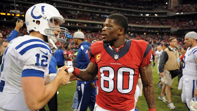 Indianapolis Colts quarterback Andrew Luck (12) talks to Houston Texans wide receiver Andre Johnson (80) after the Colts' 27-24 victory, Sunday, November 3, 2013, evening at Reliant Stadium in Houston TX.  Matt Kryger / The Star